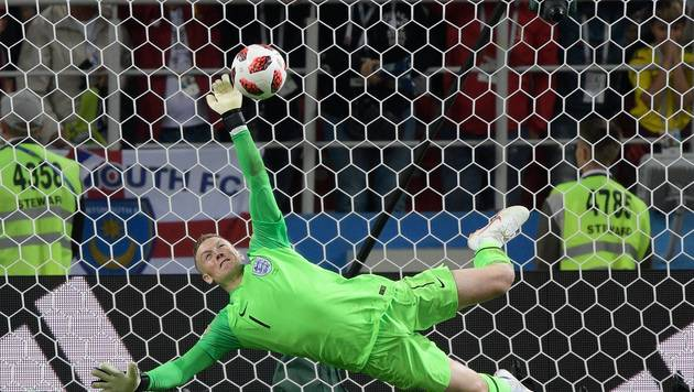 http://irofoot.s3.amazonaws.com/images/photos/article/ab42bbbc4295a994affc038afba9efe1-coupe-du-monde-2018-suede-angleterre-jordan-pickford-goal-save-the-queen.jpg